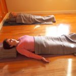 Lying on support for pranayama at Phillip island Yoga